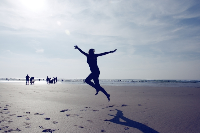 jumping for joy on the beach