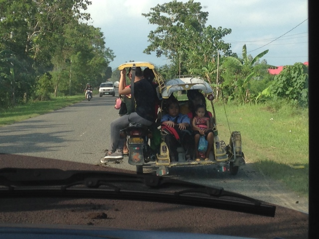 tricycles loaded up with people